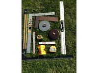 NICE LOT OF 12 ITEMS INCLUDING T SQUARES AND TAPE MEASURES RABONE STANLEY