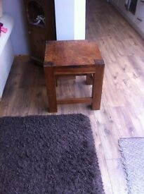 Table . Small but extremely solid wooden table . 18 inches square . Extremely desireable