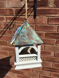 Copper roofed bird feeder