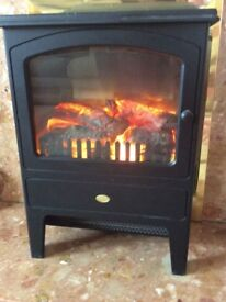 Electric fire,dimpling,good condition can be used with or without heat,log display
