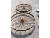 Selection of antique farm machinery wheels