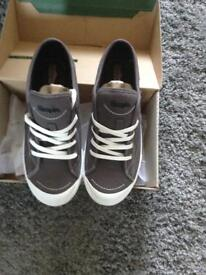 A pair of Wigman grey wide fitting gents canvas shoes .uk 9.5 43.5 in original packaging