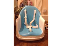 Compact high chair ideal for travel and everyday - tray hooks over the top for neat compact storage