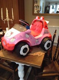 Hello Kitty motorized car with charger.