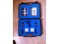 Caflon ear/body piercing kit with gun, wipes and earrings