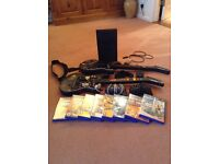 PS2 plus 2 x Guitar Hero guitars, 8 games, 2 controllers and all leads.