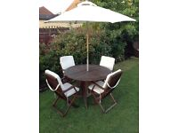 Teak garden patio circular table, 4 chairs with cushions and parasol £175 Ono tel 07966921804