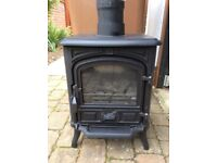 Small black steel mains gas stove with coal effect