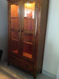 Lovely cabinet in a mid oak brought from furniture village With lights