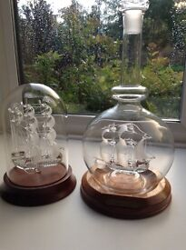 Two classic collectable glass ships in bottles
