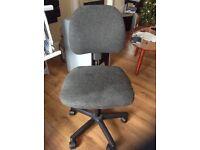 Adjustable computer chair in black / grey.