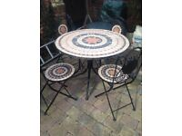 Mosaic table and 4 chairs good condition look