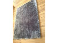 Large grey rug, very soft and luxurious