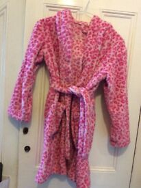 Snuggly leopard print George dressing gown. Age 9-10.