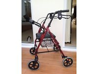 4 wheeled rollator mobility aid. Cable brakes. Padded seat. Sturdy. As new hardly used.