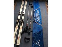 Dynamic equipe VR27 downhill skis, with poles and case as in photos.