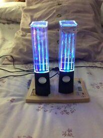 Water jet speakers