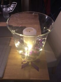 Hurricane lanterns/vases with baubles, candles and fairy lights