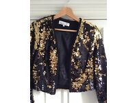 Damsel in a dress black and gold sequinned jacket