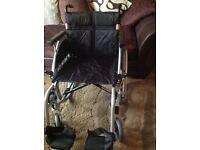 Nearly new wheel chair used only twice cost £199 will accept £75