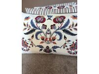 Four cushions - blue, red and white