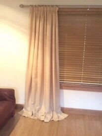 2 pairs of cream pencil pleat fully lined curtains.