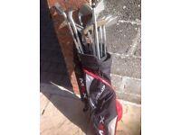 Set of golf clubs.