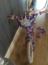 Child bike with Disney characters on and stabilisers.