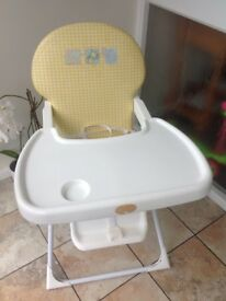 High chair for sale.