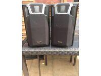 Pair of Technics speakers in black.