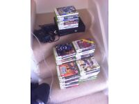 Xbox 360 S console with 54 games and 3 controllers