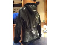 Leather jacket with hood. Lined and trimmed in warm faux fur. As new . Size M. Black/v.dark green.