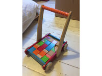Wooden push along trolley Early Learning Centre with building bricks. Good condition.