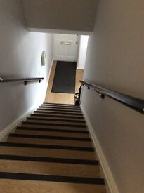 Black bannister with chrome ends and fixing