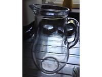 Glass jug.