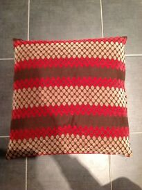 4 red, gold and brown cushion covers
