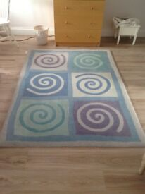 Gorgeous 'The Pier' 100% wool rug in shades of blue, grey, green, lilac. 200cm x 140cm