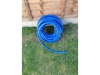 Big new roll of garden hose pipe