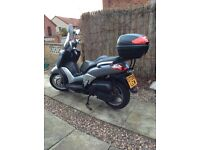 Silver Yamaha X-City 125 motor cycle for sale.
