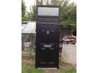 Black external uPVC door with frame