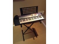 Yamaha PSR-74 Electric Keyboard with stand and power adaptor
