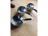 4 stainless steel saucepans