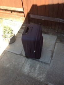Small expandable AAC suitcase in grey black for sale in good condition.