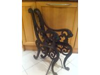 Pair of victorian lion head cast iron bench ends
