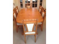 Extending Dining Table and 6 Chairs (Pine effect) - very good condition.