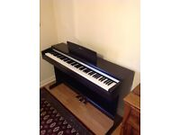 Yamaha Digital Piano YDP142 in Rosewood in mint condition.
