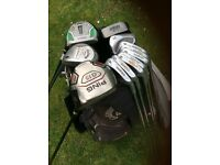 Set of golf clubs, bag and trolley