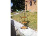 Raw iron corner stand
