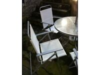 White patio set with 4 chairs and umbrella