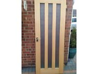 Modern Oak Colour interior door with glazed panels and handles
